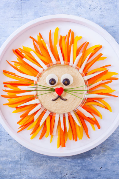 Kids and adults love this cute lion vegetable tray so much, they will stuff themselves on veggies without even realizing it! From EatingRichly.com