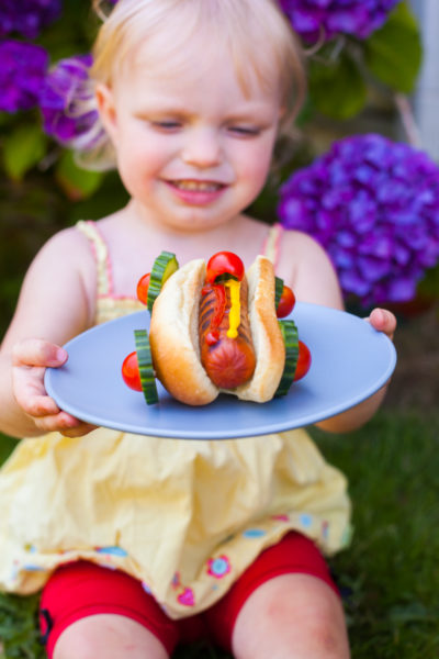 These race car hot dogs are SO cute and super easy to make. Perfect for a Cars party, a cute kid's lunch, or a backyard family barbecue. From EatingRichly.com