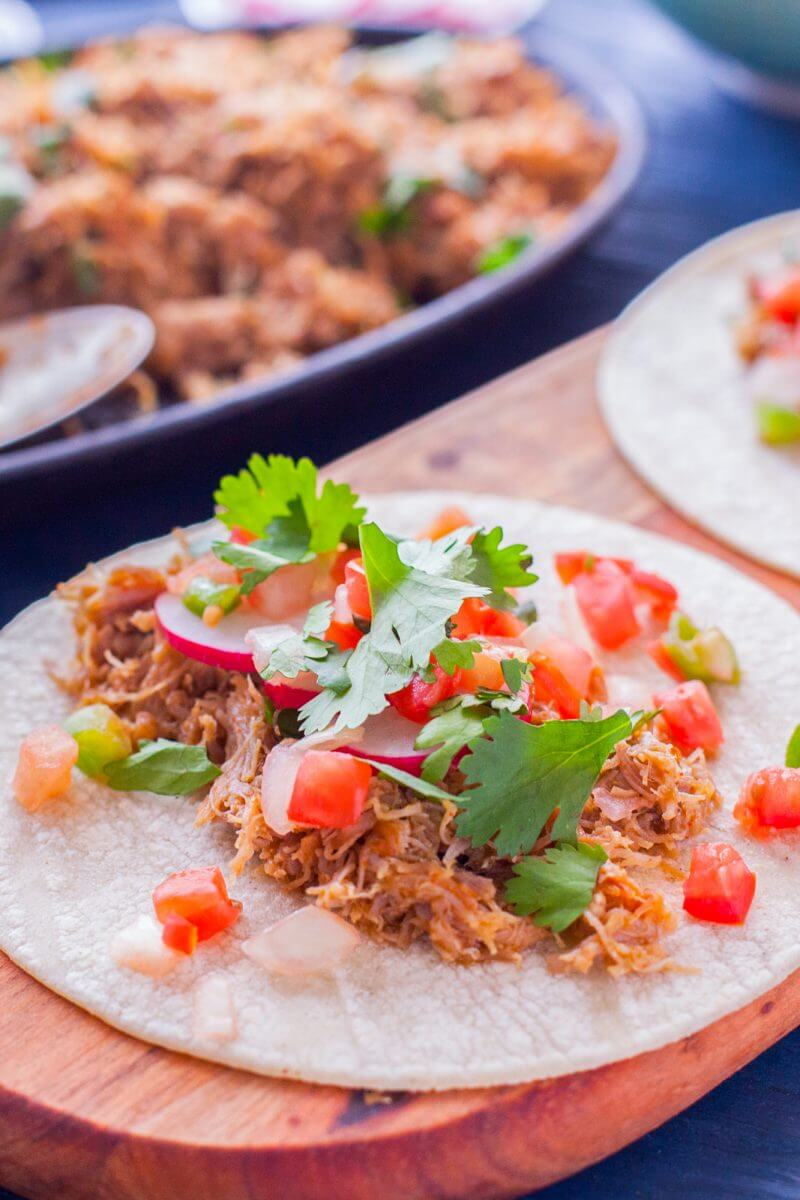 It's so easy to make healthy carnitas that are full of flavor, and using an Instant Pot helps you get your whole meal on the table in 60 minutes! From EatingRichly.com