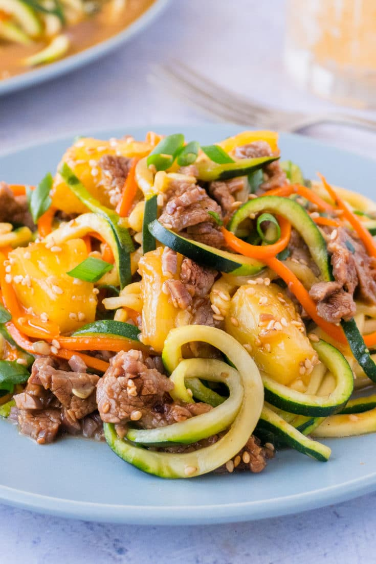 This one pot zucchini noodle stir fry combines flavorful Mongolian beef sauce, & tangy pineapple, with zoodles to make a healthy, easy, complete meal.