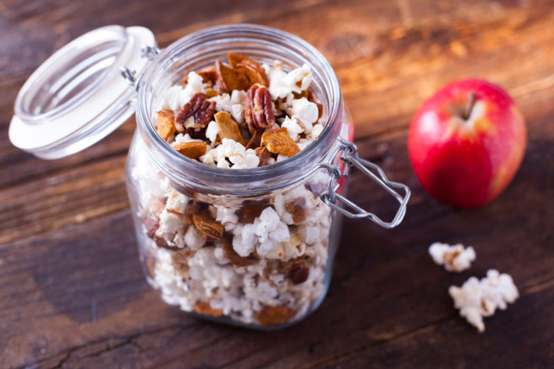 This healthy cinnamon popcorn recipe tosses dried apples, pecans, and air popped popcorn in a light cinnamon butter, for an irresistible snack mix. From EatingRichly.com