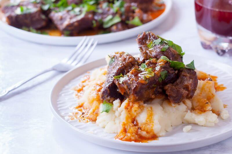 This pressure cooker short ribs recipe makes fall apart tender boneless beef short ribs in under an hour using the Instant Pot or your favorite pressure cooker. You won't believe it until you try it! From EatingRichly.com