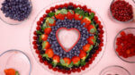 raspberries, Blackberries, Strawberries and blueberries around a heart cookie cutter