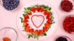 Strawberries around a heart cookie cutter