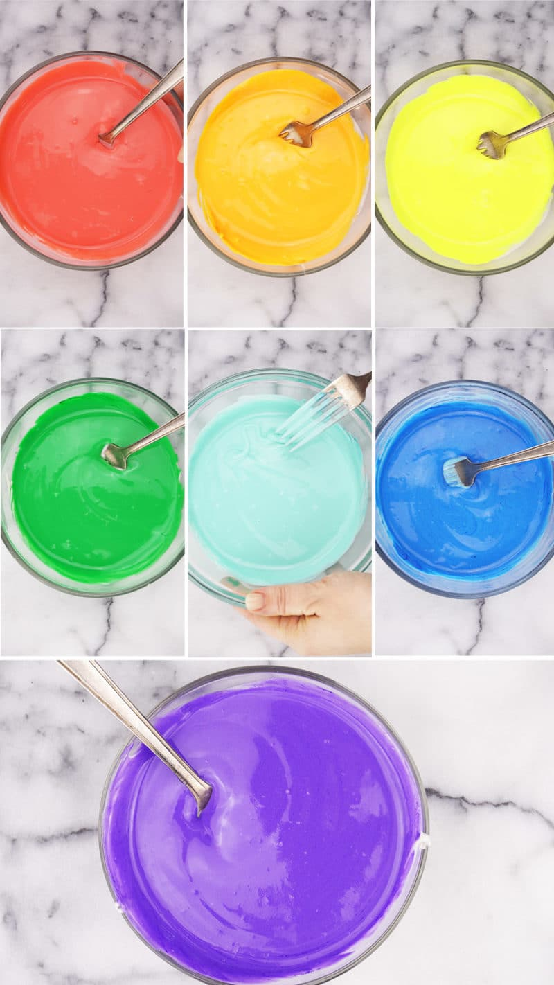 7 bowls of cheesecake filling each dyed a different color of rainbow