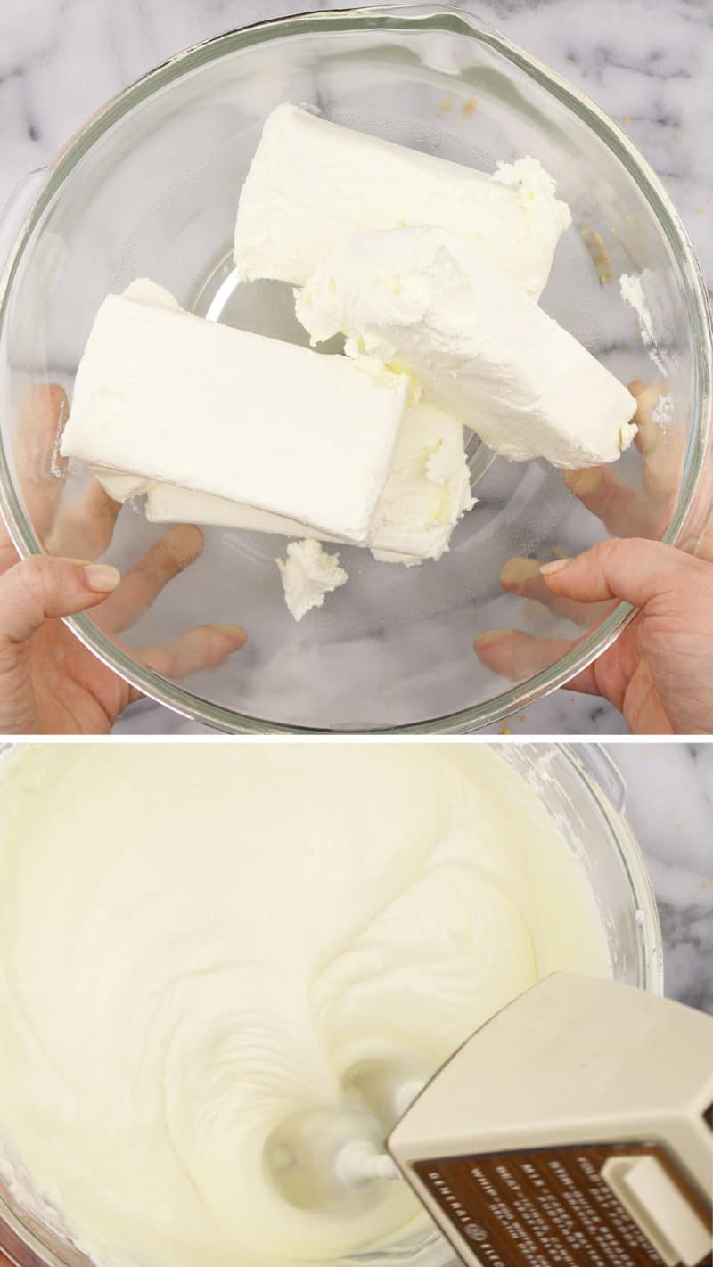 Hands holding a bowl filled with cream cheese blocks above a bowl of cheesecake filling being mixed