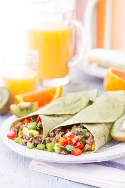 Breakfast Burrito plate with juice and fruit