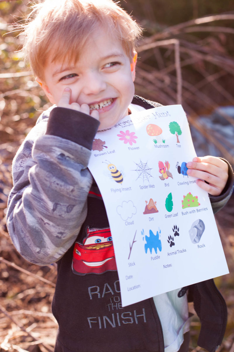 Boy Holding Nature Scavenger Hunt Printable