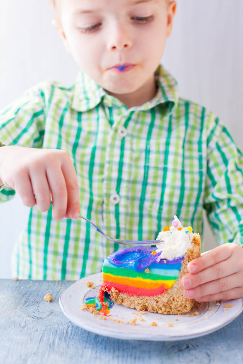 child eating rainbow cheesecake