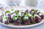 tzatziki sauce on lamb kofta skewers