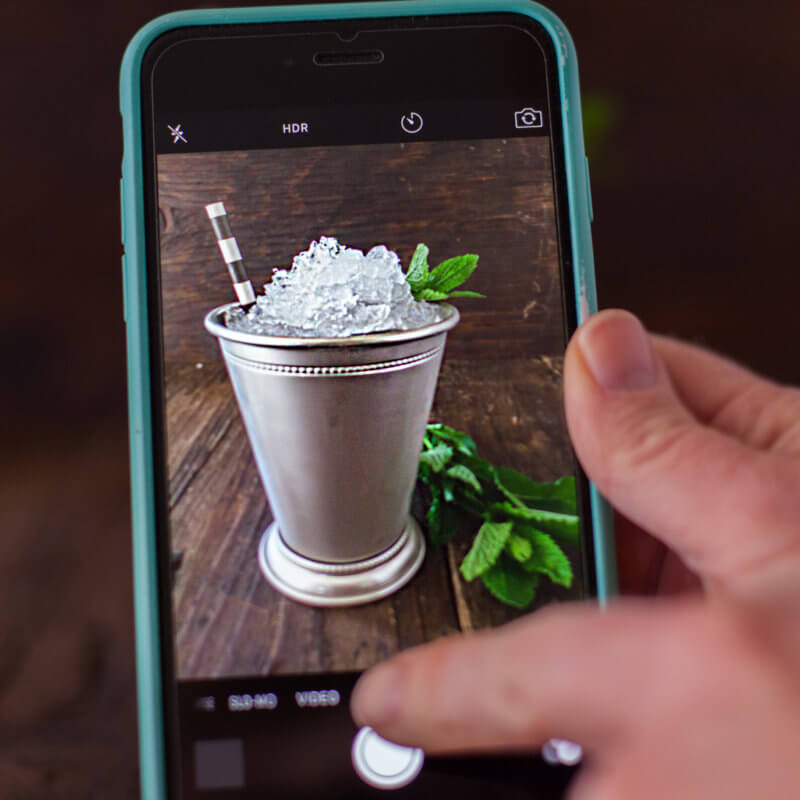 Phone photographing a mint julep