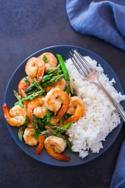 Shrimp and Asparagus Stir Fry on a Plate with Rice