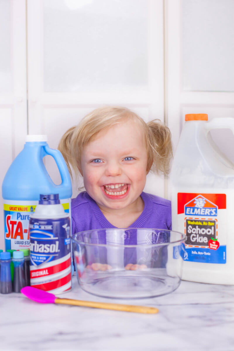 toddler with fluffy slime recipe ingredients