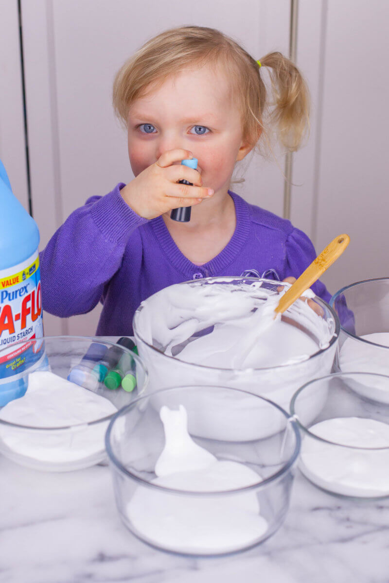 toddler making fluffy slime