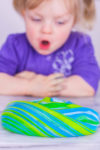 toddler excited about fluffy slime