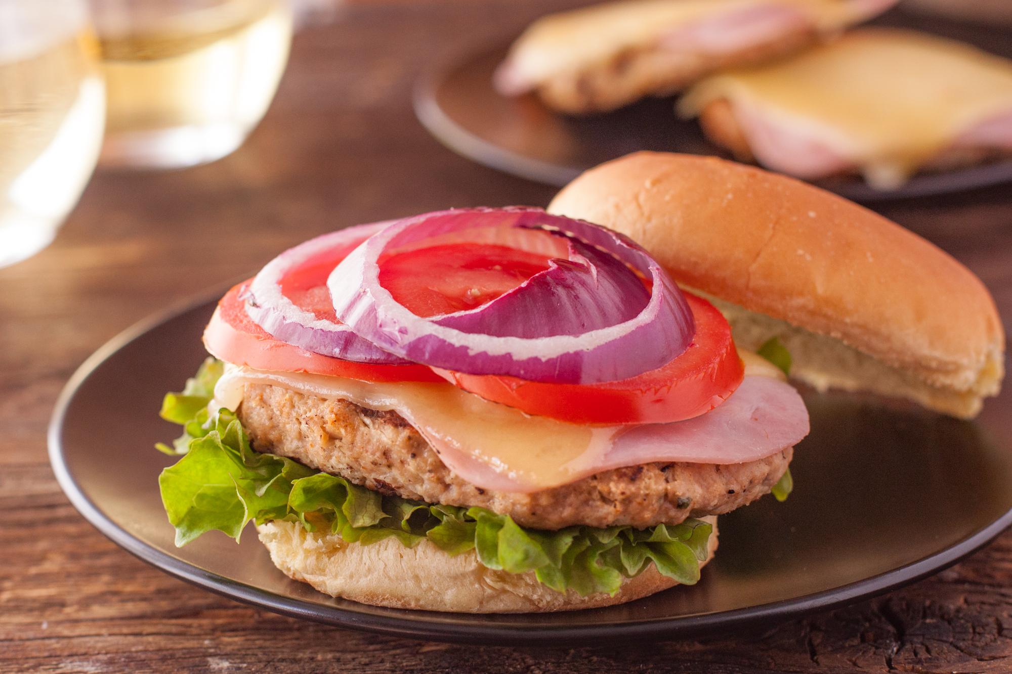 Toppings on a chicken burger cordon bleu
