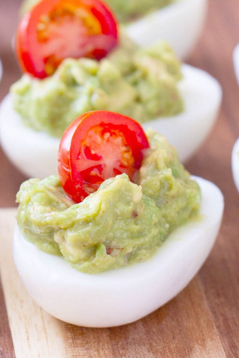 Guacamole Deviled Eggs with Cherry Tomato Garnish