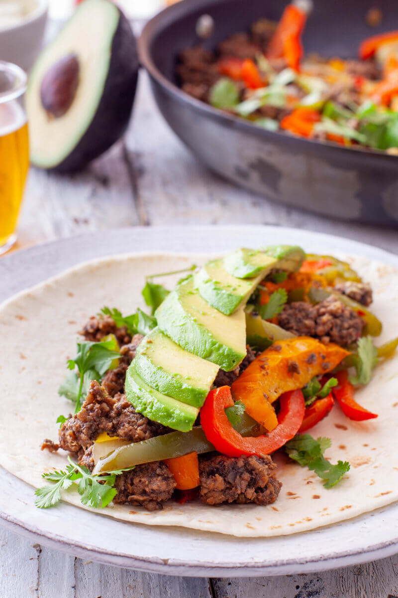 Ground Beef Fajitas Recipe with Avocado and Cilantro Toppings