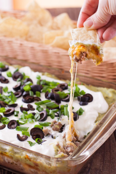 Baked 7 layer dip cheese melted