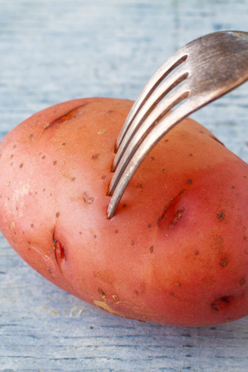 Steamed Potato with a Fork Poking It