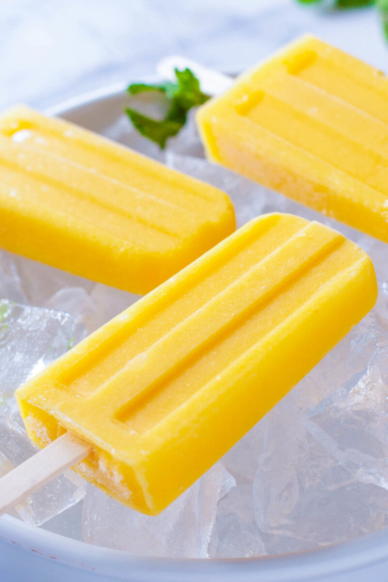 Mango Popsicles in Bowl of Ice