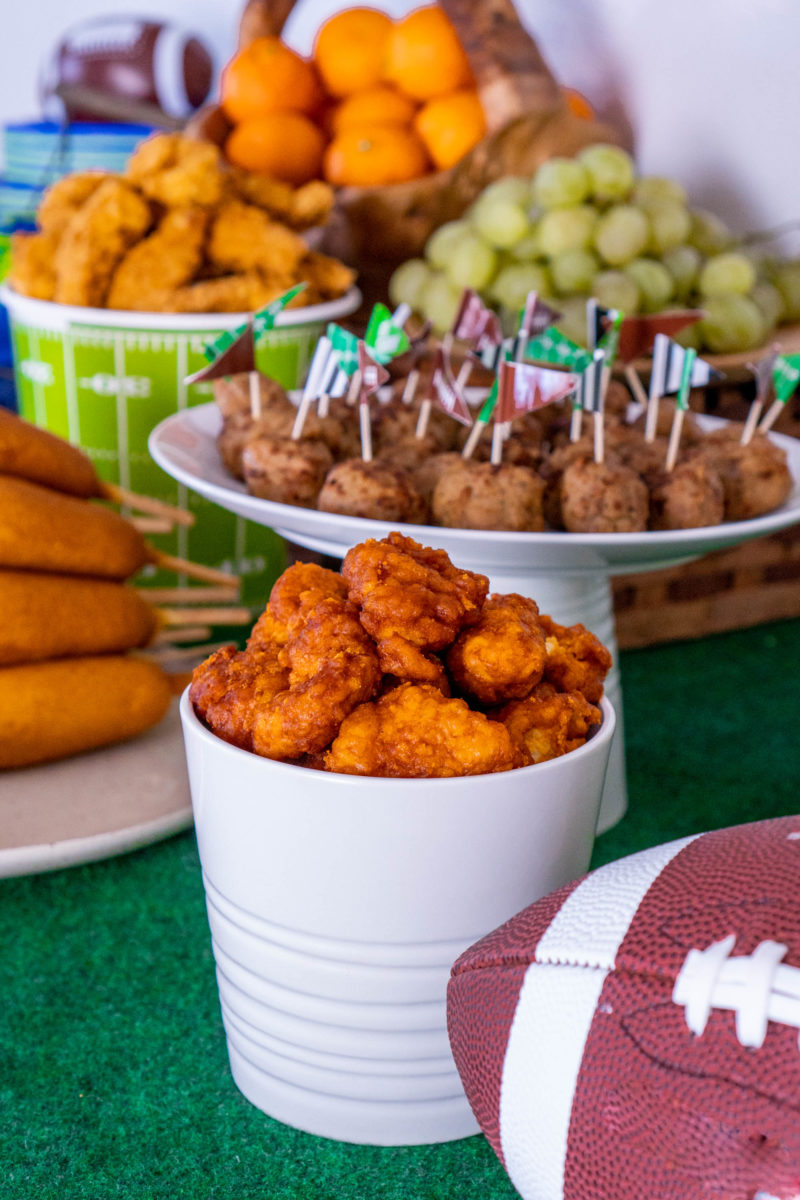 Decorations and snacks on game day food buffet table