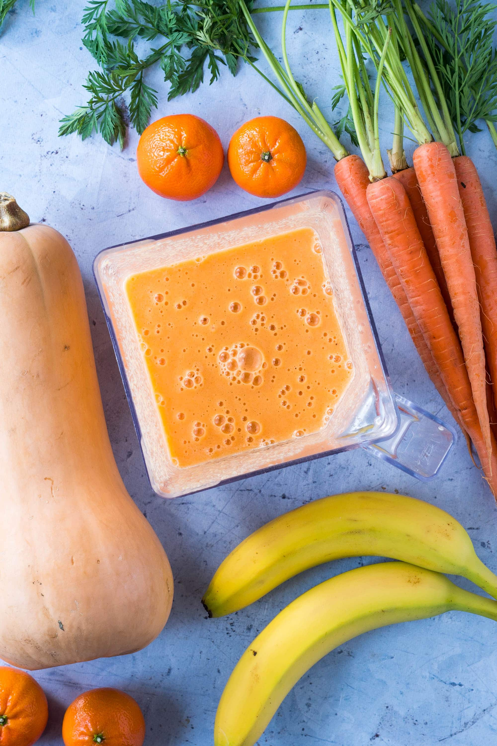 Tangerines, carrots, butternut squash, bananas in an orange creamsicle smoothie