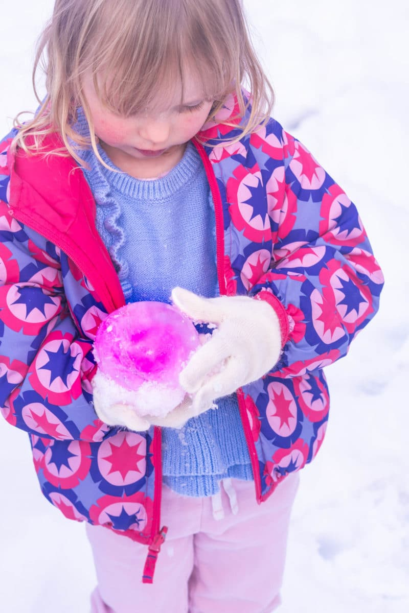 Girl holding pink ice balloon
