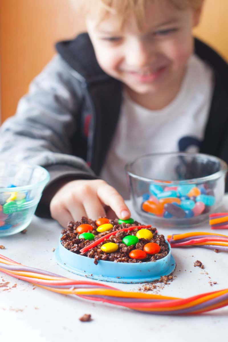 Child decorating chocolate Easter Rice Krispie Treats