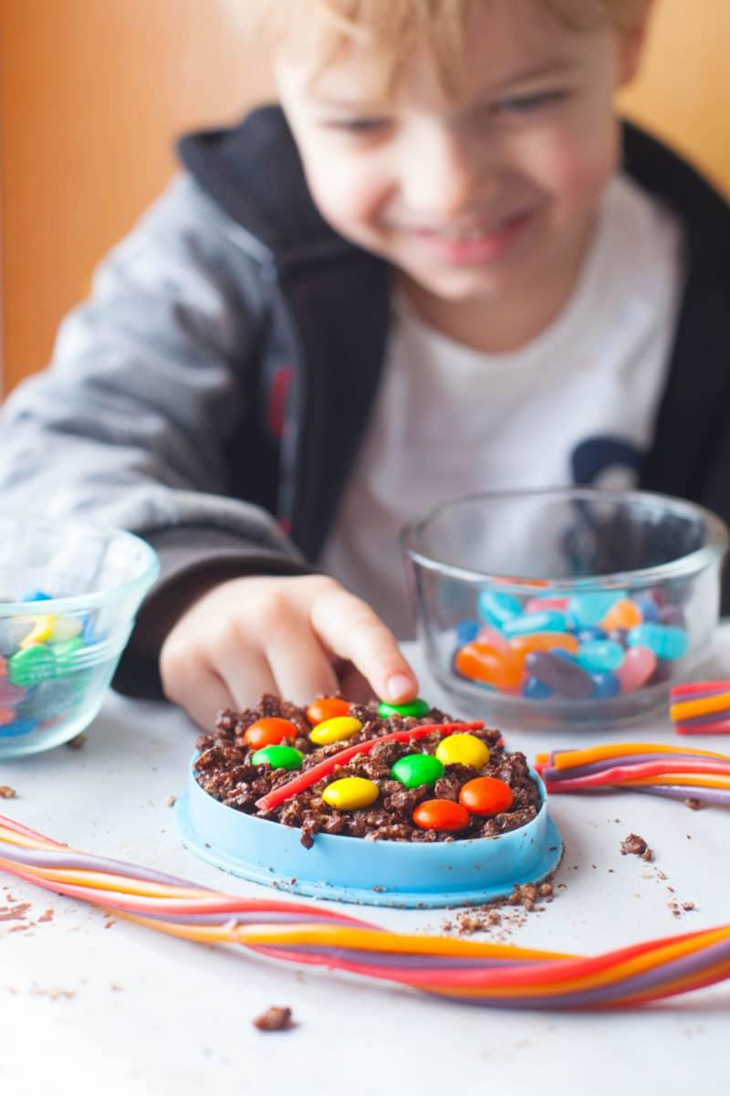 Child decorating chocolate Easter Rice Krispie Treats