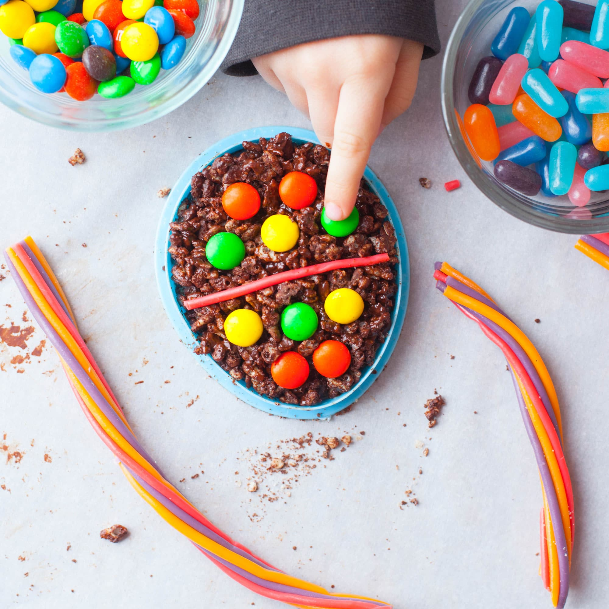 Child decorating chocolate Easter Rice Krispie Treat