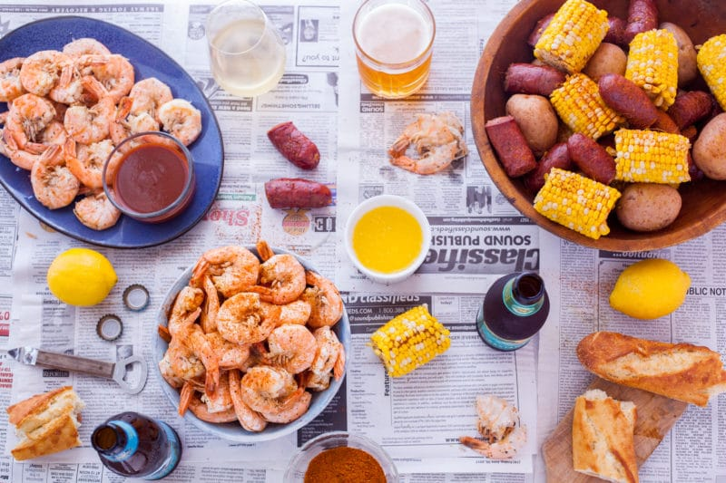 Table with Shrimp Boil Food and Beer