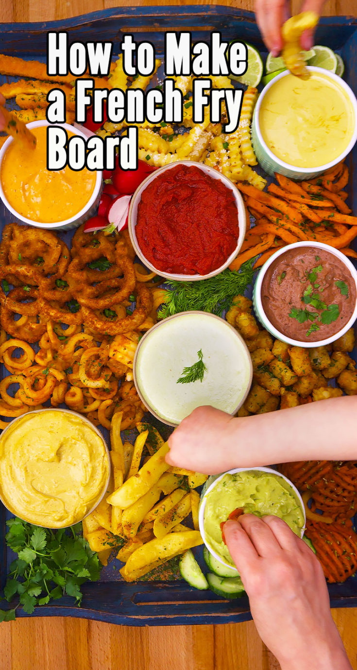 French fry boards are the hottest new food trend. If you love cheese boards, charcuterie boards, veggie trays, fruit platters, and any kind of grazing board, you've got to try a fries board. Here's how to make one including some amazing homemade dip recipes. #fryboard #friesboard #frenchfryboard #frenchfrycharcuterieboard #frenchfrycheeseboard #frycharcuterieboard #partyfood #appetizerrecipes