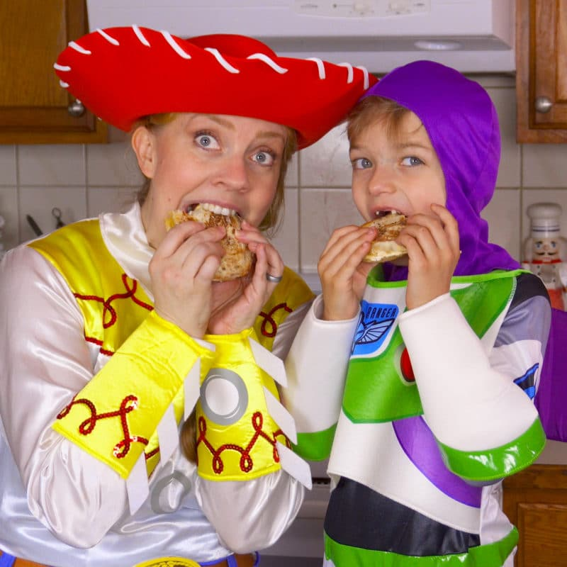 Eating grilled cheese sandwiches in Toy Story Costumes square