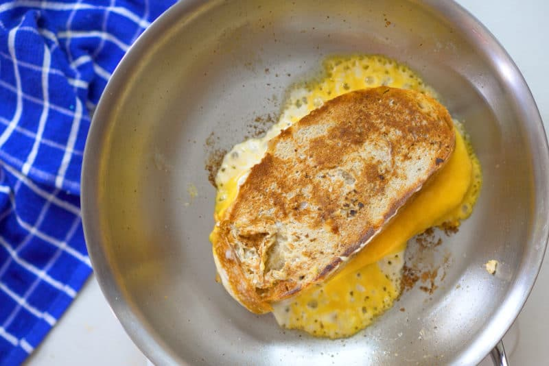leaking grilled cheese in skillet