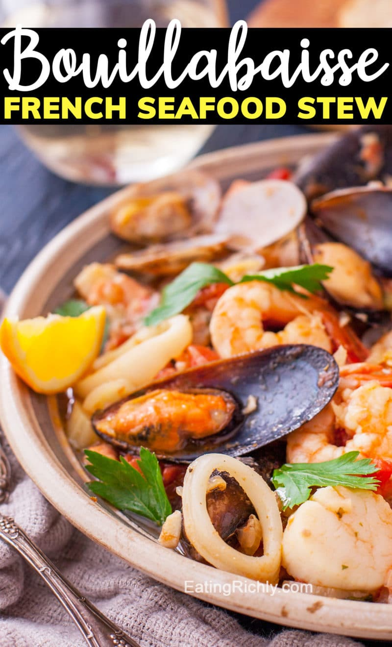 Bowl of seafood soup with text saying bouillabaisse French seafood stew