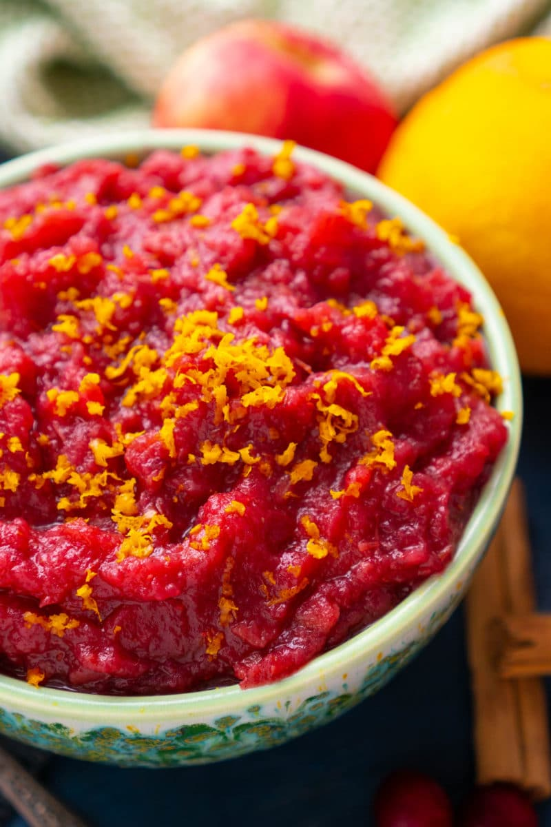 Closeup of Cranberry applesauce topped with orange zest