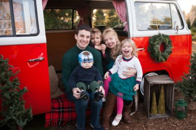 Family of Five Smiling at Christmas Tree Farm