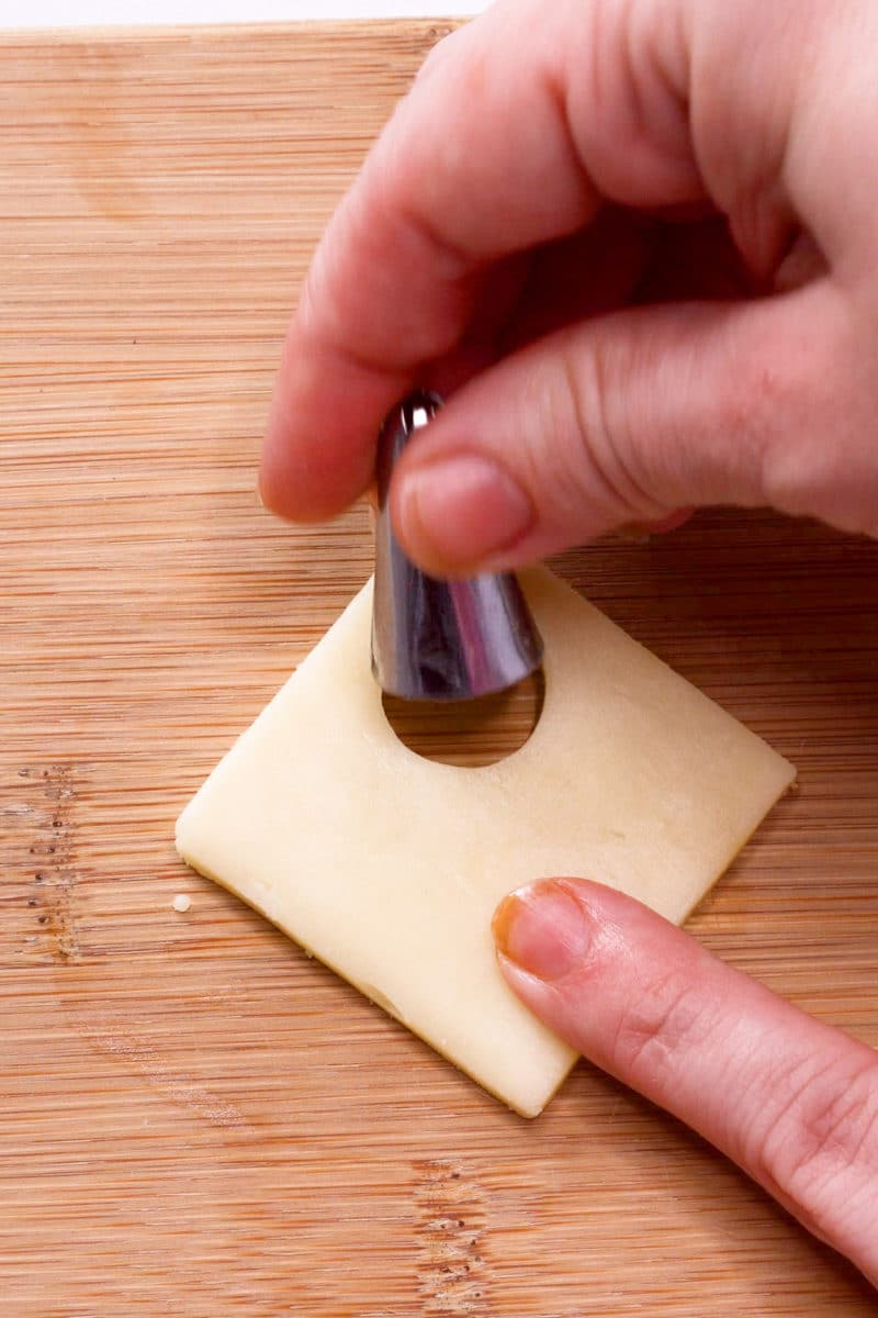 Cutting circles from white cheese using a frosting tip
