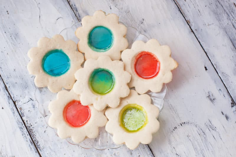 "Simple flower shaped stained glass cookies with colorful candy ""glass"" circles"