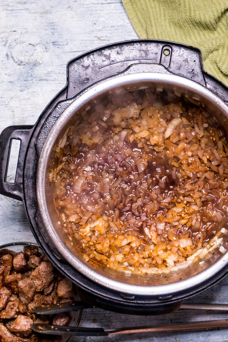 Cooked onions with wine and beer in Instant Pot for German goulash