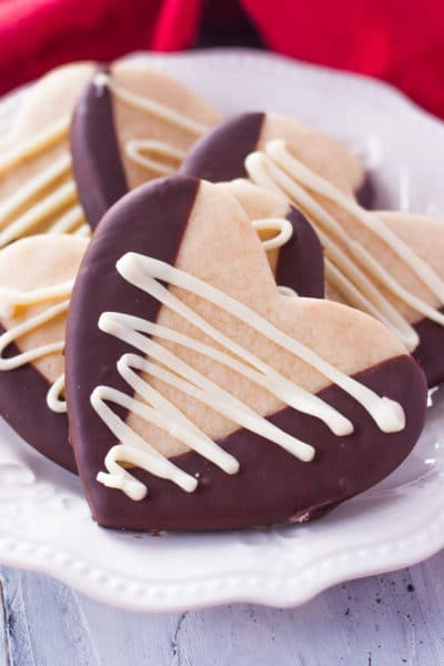 Heart shaped chocolate dipped Valentine's Day sugar cookies