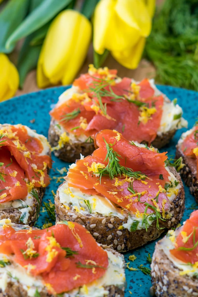 Spring appetizer of toast topped with lemon herb butter and smoked salmon